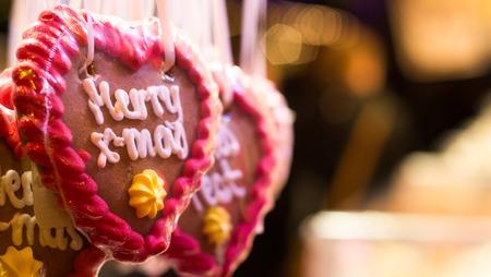 Heart shaped gingerbread Merry x-mas at christmas market Stock Photo