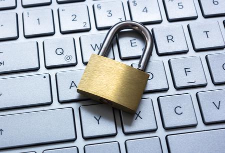 edv: Padlock on a laptop keyboard