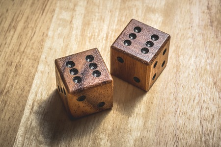 double the chances: Two wooden dice with the number 6 on a table.