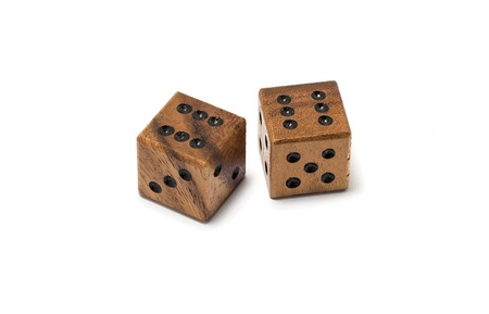 Two isolated wooden dice with number 6.