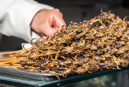 Fried scorpions as snack at streedfood market - Beijing, China.