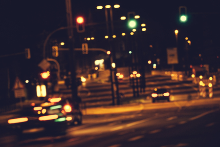 Bokeh effect from street lights and car at night.