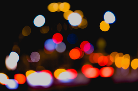 colourful lightings: Bokeh effect from street lights and car at night.