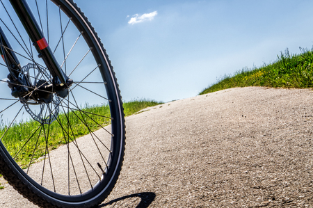 Cyclist goes uphill.