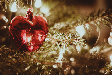 Red heart on a christmas tree Imagens