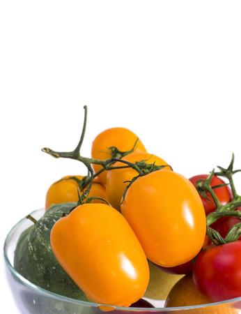 cantaloupe: Tomatoes and cantaloupe on a glass bowl