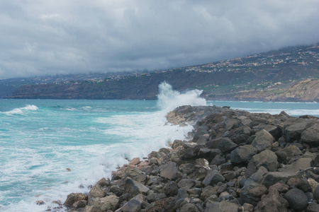 Ocean waves crashing against rocks. landscape on tenerife Stok Fotoğraf