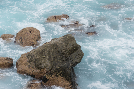 stones in the ocean and waves. beautiful azure landscape of Canary Islands