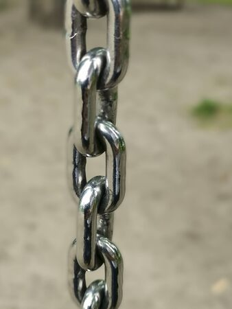 Metal chain close up background. Links Of A Heavy Silver iron metal chain Close-Up View. strength and power concept