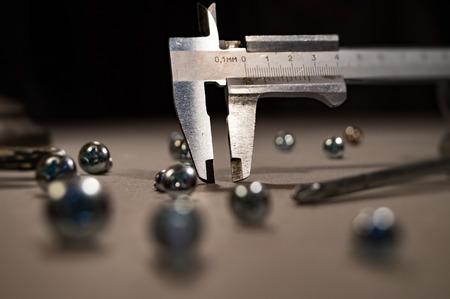 trammel: Trammel and screws. Abstract composition