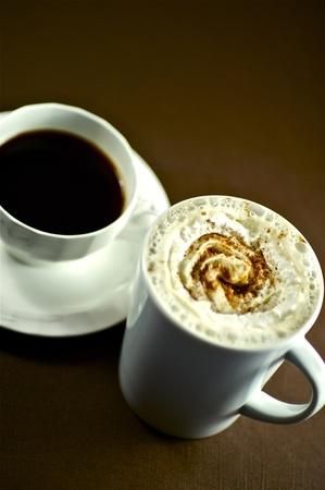 Coffee Break. Two Fresh Coffee Caps - Dark Brown Background. Stock fotó