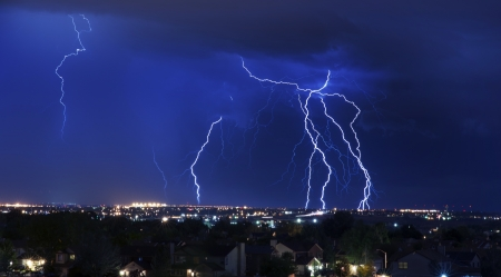 Lightning Storm Over South-West Colorado Springs, Colorado, USA. Overnight Heavy Thunderstorm - City, Storm Cloudscape and Few Lightnings. Powerful Nature Photo. Stock Photo - 10642838
