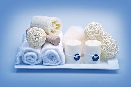 Bath Decoration & Relaxation Kit. Fresh Clean White Towels, Candles and Decorative Elements. Bath Deco. Blue Tones Horizontal Studio Photo. Archivio Fotografico