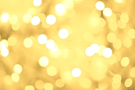 Golden Bokeh Background. Blurred Golden Background - Blurred Lights. Christmas Golden Background