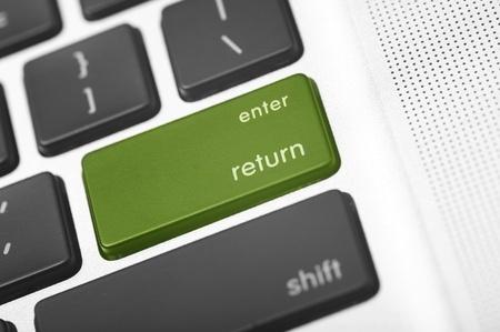 Green Return Laptop Button. Grayscale Keyboard Macro Shot with Green Enter - Return Button. Stok Fotoğraf