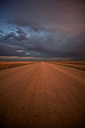 Colorado Plains No Pavement Country Road - El Paso County, Colorado USA. Vertical Evening Shot. photo