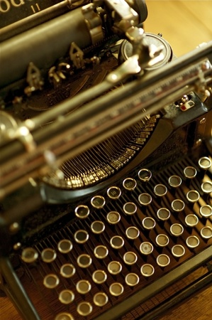 Old Typewriter Machine - Retro / Vintage Typewriter. Vertical Photo. Antique Photo Collection