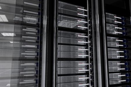 hospedagem: Dark Servers Room. Glassy-Metallic Server Racks. Wall of Servers. Dark Server Room 3D Generated Illustration. Hosting Related Theme.