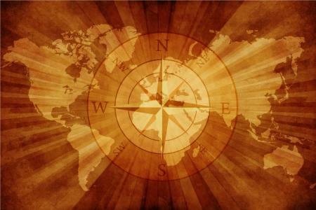 オールド世界地図とコンパス ローズ。汚れた古い紙の世界地図とコンパス。 写真素材