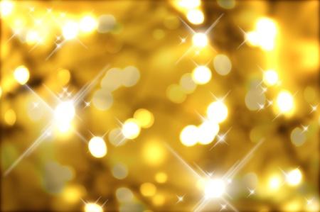 sfondo luci: Freddo sfondo dorato di Natale con luci flash e Bokeh.