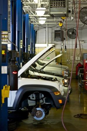 service lift: Auto Service. Few Vehicles in Car Service.