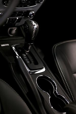 Modern Interior Car Design. Black Leather Vehicle Interior with Chrome Elements. Vertical Photo. Redakční
