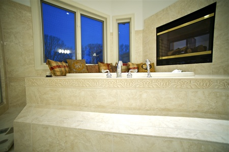 Jacuzzi Tube with Fireplace. Fancy Bathroom Interior.