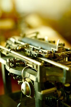 Part of Vintage Typewriter . Old School Typewriter Machine Vertical Photo. photo