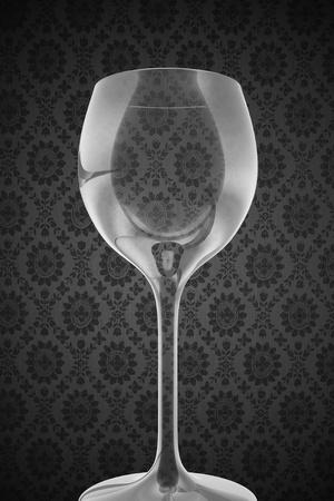Empty Wine Glass on Retro Gray Background. Simple Wine Theme - Grayscale. photo