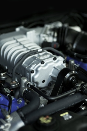horse pipes: High Performance Vehicle Engine. This Powerplant Generates More Than 400 Horsepower. Vertical Photo.