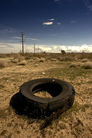 Broken Tire - California Outback. East from Los Angeles Deserts. Vertical Photo