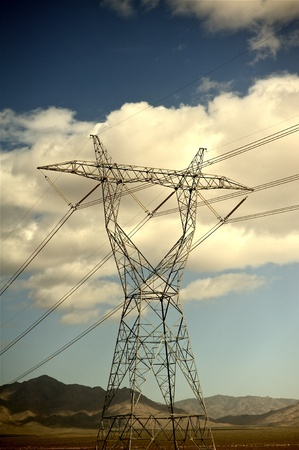 high desert: High Voltage Power Lines in Nevada Deserts, USA. Cloudy Summer Sky. Vertical Photo Stock Photo