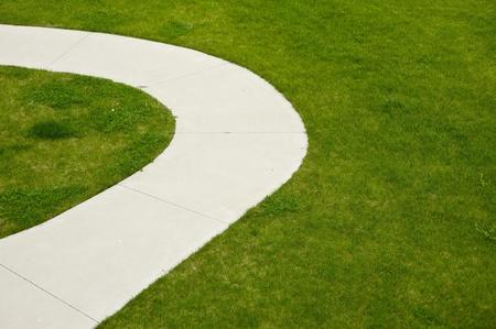 cut grass: Backyard Sidewalk. Green Fresh Cut Grass