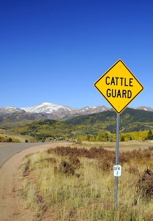 cattle guard: Cattle Guard Road Sign - Cattle Grid Known as a Vehicle Pass, Texas Gate - Colorado Landscape
