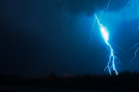 thunder storm: Lightning Storm. Powerful Lightning Bolt on Dark NIght Sky. Electric Storms Photo Collection.
