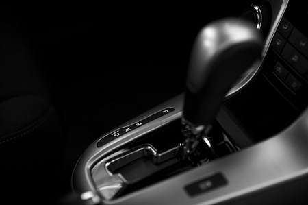 Automatic Transmission Control in Modern Vehicle. Black and White Dark Studio Photo. photo