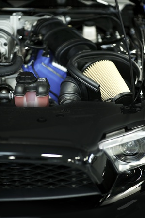 air filter: Sport Vehicle Air Filter - Muscle Car Under the Hood. Performance Engine.