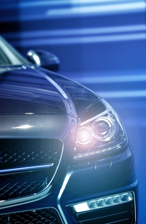 auto sales: Headlight On Vehicle - Modern Vehicle Front Headlight. Stock Photo