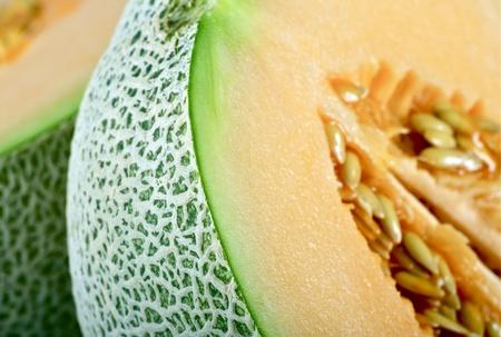 referred: Cantaloupe Melon in Closeup Photography. Originally Cantaloupe Referred Only to the Non-Netted Orange Fleshed Melons. Cantaloupe Melon Horizontal Photo. Stock Photo