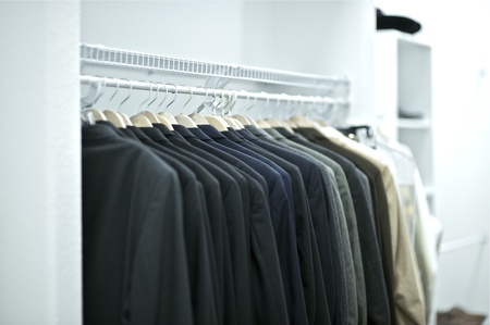 Elegant White Full of Light Suits Closet Horizontal Photography. Suits Collection. Home Inters Photo Collection Stock Photo - 12788964