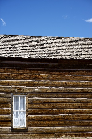 u s a: Vintage Building - Very Old Colorado Log House with Small Window  Vertical Photography  Colorado U S A