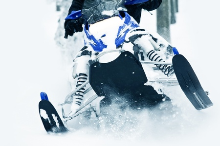 snowmobile: Extreme Snowmobiling - Snowmobile Winter Fun  Men Riding Snowmobile in  Deep Snow  Editorial