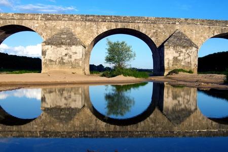 oldish: Vintage Stones Bridge. Old French Stone Bridge. France, Europe. Stock Photo