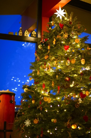 decoration: Beautiful Christmas Tree Under High Roof. Holidays Christmas Theme. Vertical Photography.