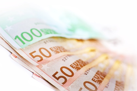 investor: European Union Currency - Euros Bills  50 and 100 Euro Bills in Closeup Photography  Stock Photo