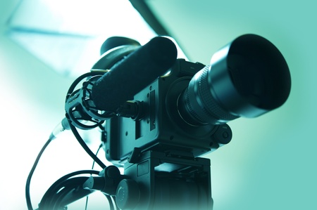 sound recording equipment: HD Video Camera with Shotgun Microphone. Video Production - Broadcast Theme. Stock Photo