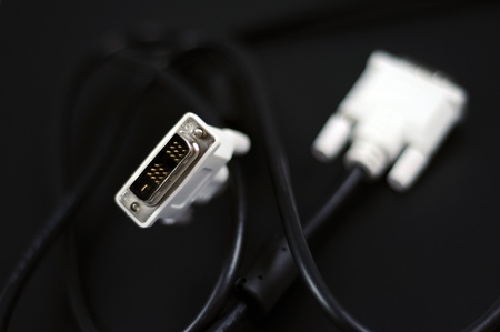 dual: White DVI-D Dual Link Digital Monitor Cable on Solid Black Background  Technology Photo Collection  Stock Photo