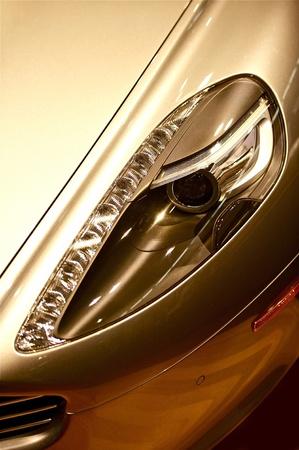 Elegant Luxury Car Headlight Closeup. Expensive Sporty Car Headlight.