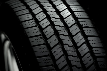 Car Tire on Black Background. Car Tire in the Dark - Spot Light Stock Photo - 12787762