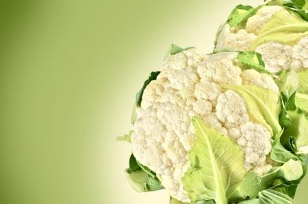 Fresh Cauliflowers on Green Background. Raw Whole Cauliflowers Horizontal Photo.